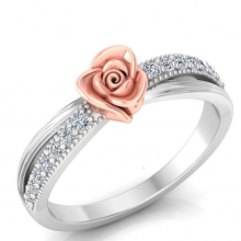A vintage gold and diamond ring with a flower