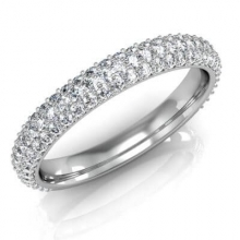 A wedding ring studded with diamonds