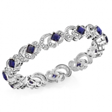 A gold and diamond bracelet with sapphire gemstone