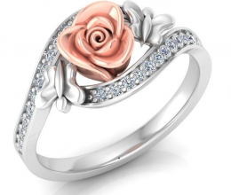 A gold and diamond ring with a flower design and butterflies