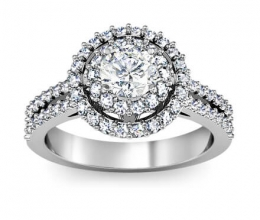A luxury ring with a central stone and two rows of diamonds